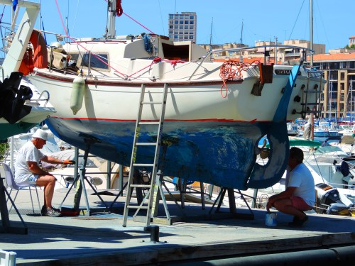 Locals doing a little boat maintenance